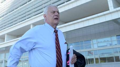 John Venditto arrives at the federal courthouse in