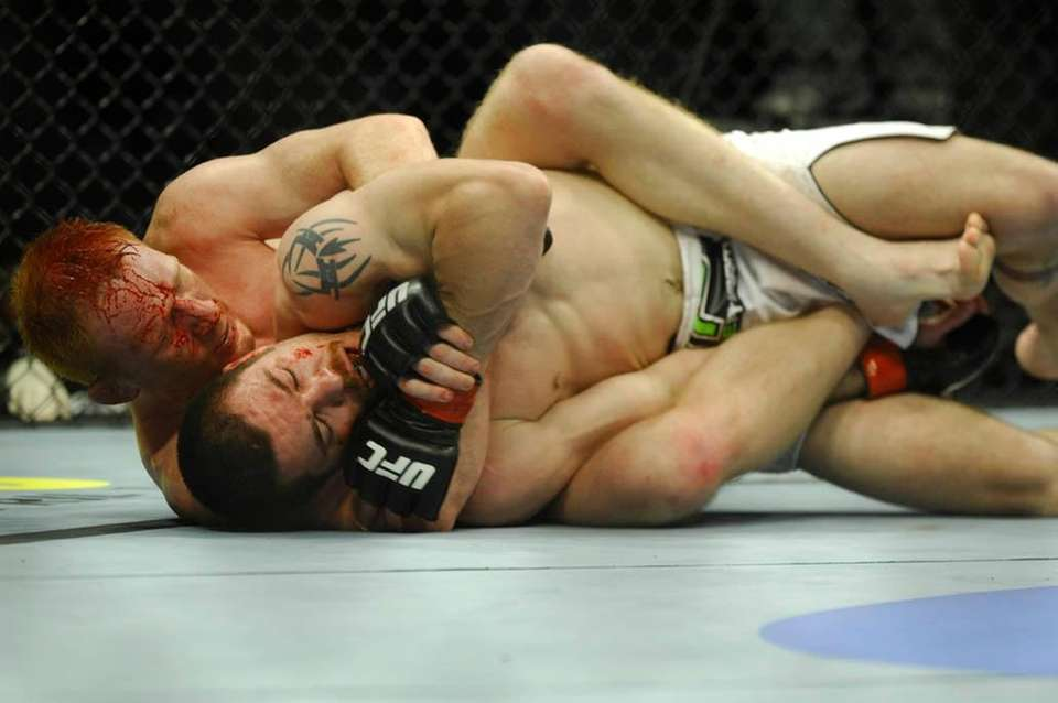 Mark Bocek works for a submission choke against