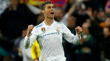 Real Madrid's Cristiano Ronaldo celebrates after defeating Bayern