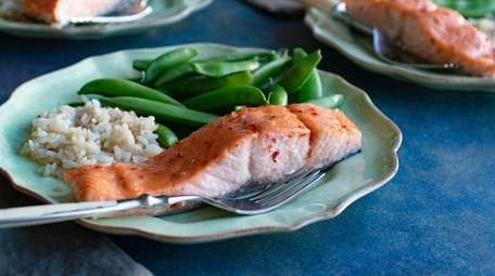 Salmon is brushed with a glaze made with