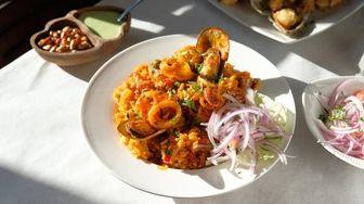 Arroz con mariscos features short-grain rice, calamari and