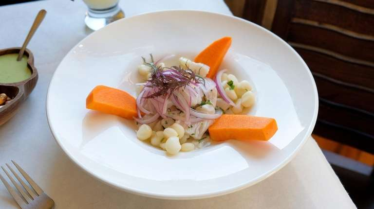 Ceviche de pescado, spicy marinated fish, is garnished