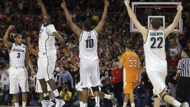 Michigan State players celebrate after their 70-69 win