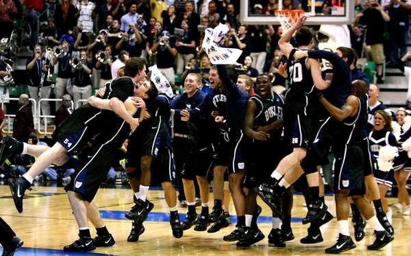 The Butler Bulldogs celebrate a 63-56 victory over