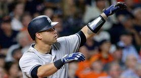 Yankees catcher Gary Sanchez watches his three-run homer