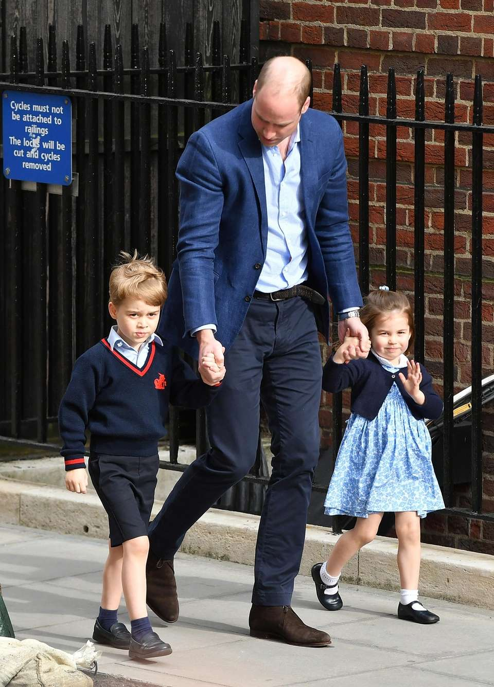 Princess Charlotte arrives with Prince William and Prince