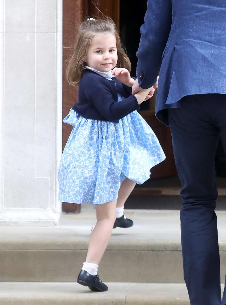 Princess Charlotte waves as she enters the Lindo