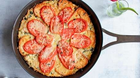 Bread, tomatoes and zucchini are cooked, casserole style,