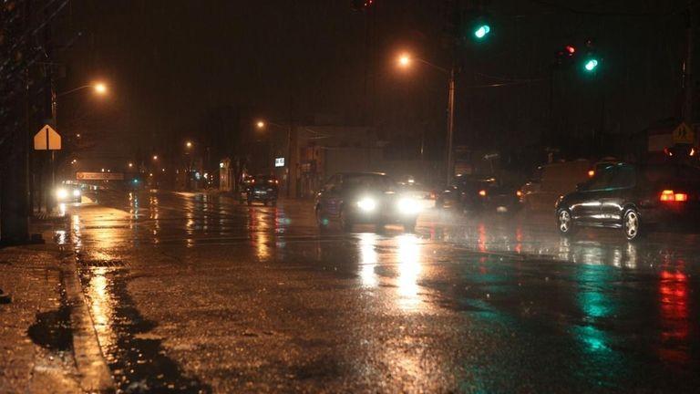 Rain soaks Jericho Turnpike in Mineola during a