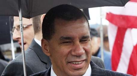 New York Governor David Paterson attends a ribbon-cutting