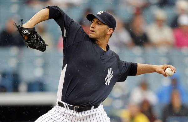 New York Yankees pitcher Andy Pettitte throws in