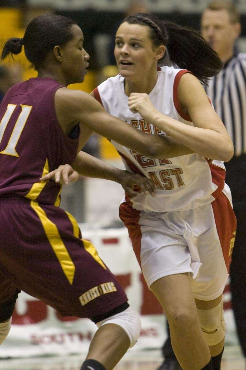 Sachem East's Kristen Doherty is tightly guarded by
