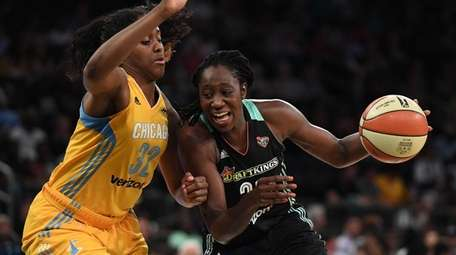 Liberty center Tina Charles drives to the basket