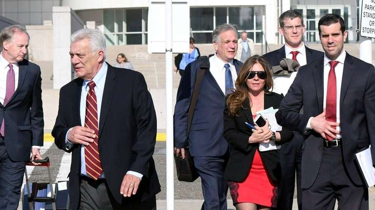 John Venditto, left, and Edward Mangano leave the