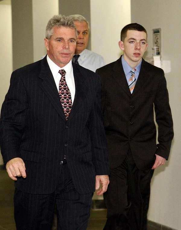 Nicholas Hausch, right, is brought in to testify