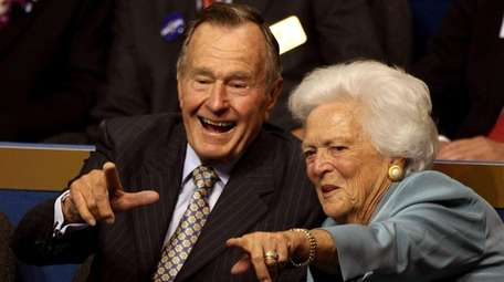 George H.W. Bush and Barbara Bush attend the