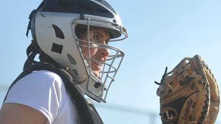 Jill Meaney, Smithtown West catcher, sets up behind