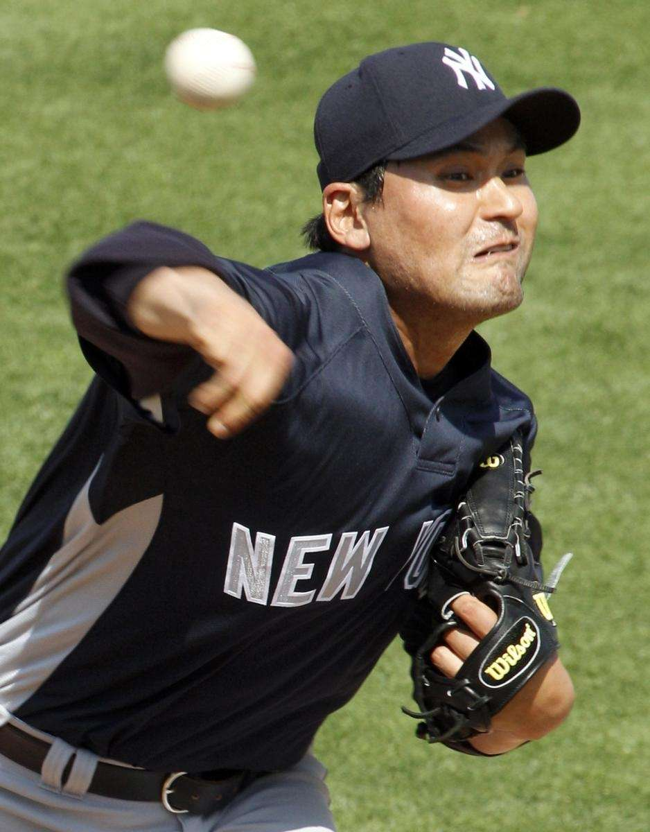 New York Yankees pitcher Chan Ho Park throws