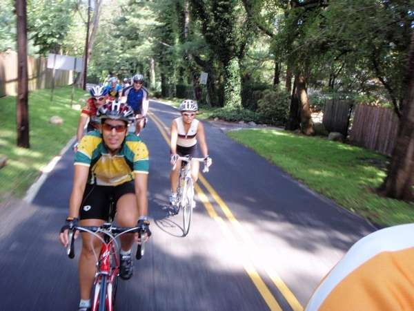 Riders from the Massapequa Bike Club bicycle through