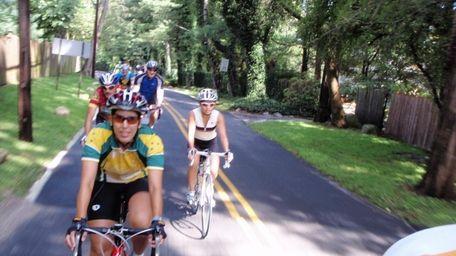 Riders from the Massapequa Bike Club bicycle through