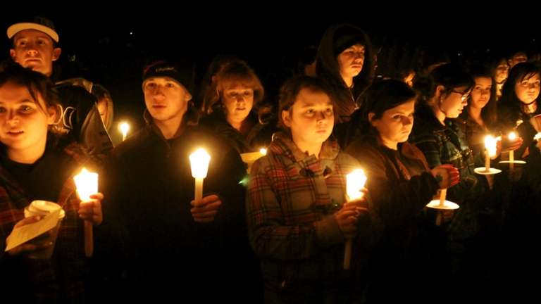 A candlelight vigil is held at South Hadley