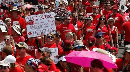 Thousands march to the Arizona Capitol for higher