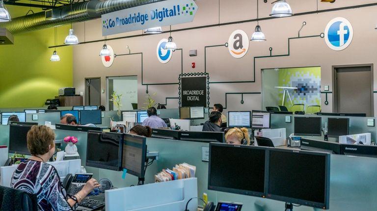 Broadridge Financial Solutions employees work at their Edgewood