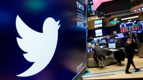 The Twitter logo is displayed above a trading