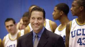 UCLA basketball coach Steve Lavin smiles during media