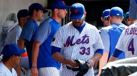 Matt Harvey of the Mets walks through the