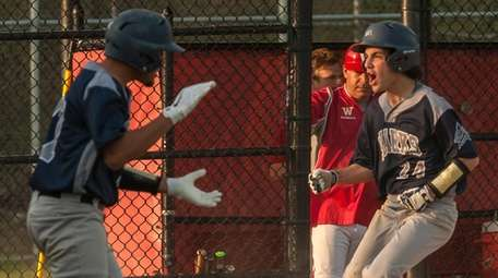 Eastport-South Manor's Trevor Zanderzuk scores an insurance run