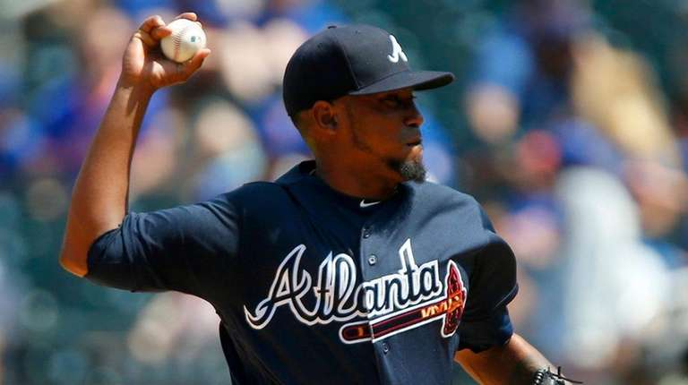 Braves pitcher Julio Teheran delivers during a game