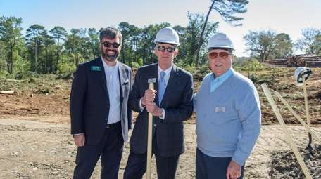 Andy Isakson, center, owner of Isakson Living, with