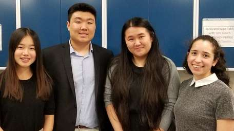 From left, Manhasset H.S. students Vanessa Zhang, Fred