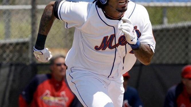 Jose Reyes runs to first base during a