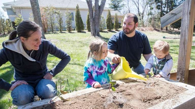 The Sarin family, from left, Pamela, Olivia, 3,