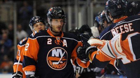 Islanders defenseman Mark Streit is congratulated after scoring