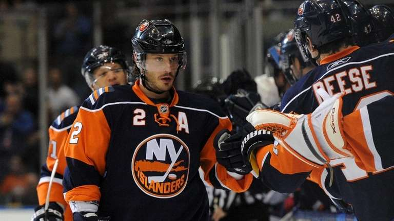 Islanders defenseman Mark Streit is congratulated after scoring