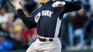 New York Yankees' Mark Teixeira reacts after he