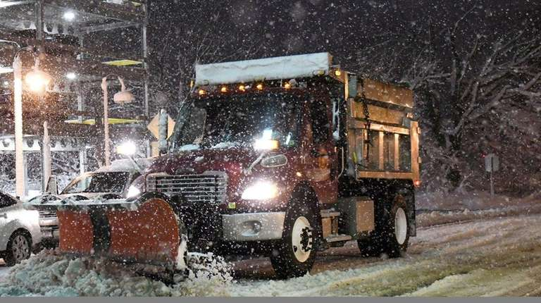 A Brookhaven Town truck plows snow along Railroad