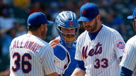 Matt Harvey of the Mets hands the ball