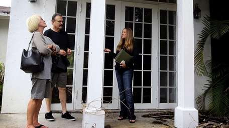 Real estate agent Shellie Young shows a home