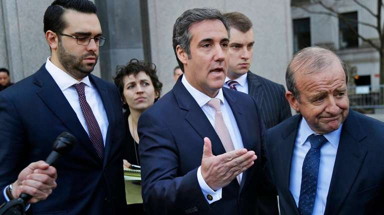 Michael Cohen, center, leaves federal court in Manhattan