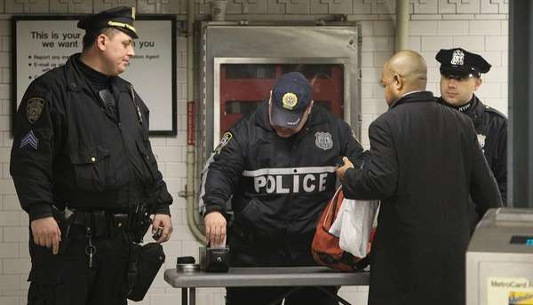 A file photo of NYPD officers inspecting bags