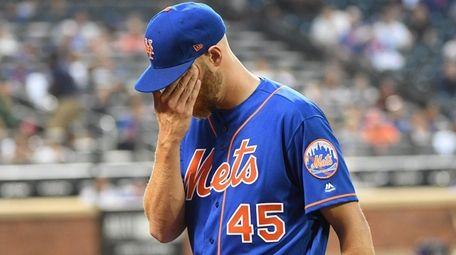 Mets starting pitcher Zack Wheeler walks to the