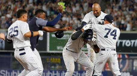 Miguel Andujar of the Yankees celebrates his ninth-inning