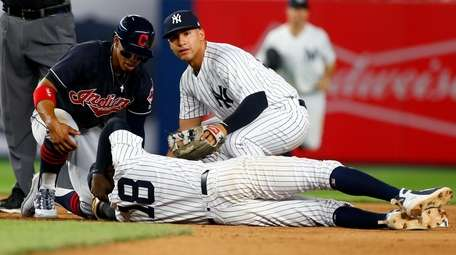Gleyber Torres of the Yankees checks on teammate