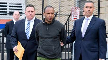Andre Patton, 47, of Roosevelt is taken to