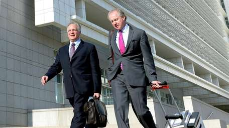 Edward Mangano, left, leaves the federal courthouse in