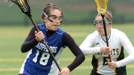 Hauppauge's Jessica Venturino (18, left ), tries to